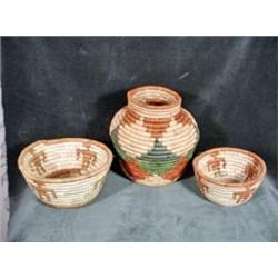 COLLECTION OF THREE PALM BASKETS HANDWOVEN BY VILLAGE WOMEN IN PAKISTAN USING THE RENEWABLE NATURAL