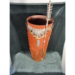 RUSTIC SOFT SUEDE, FEATHER, AND CONCHO DECORATED TALL CONTAINER WITH HANDLES AND DECORATIVE ARROW. 1
