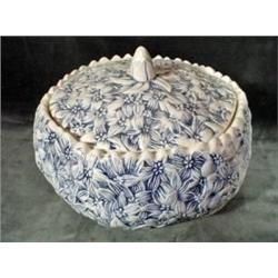 "UNIQUE COVERED CASEROLE WITH DAISY FLOWERS EMBOSSED THROUGHOUT IN NAVY AND CREAM.  UNSIGNED. 3.5""X8"""