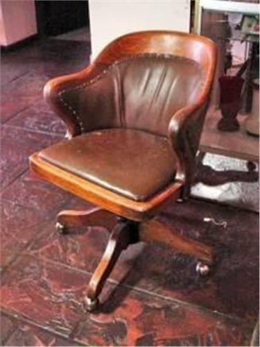 ANTIQUE WOOD AND LEATHER DESK CHAIR WITH BRASS TACK FINISH AND CASTERS. 34  X23. Loading Zoom