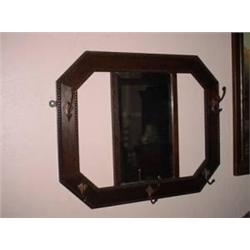 BEVELED WALL MIRROR FRAMED BY A GEOMETRIC SHAPED