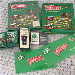 LOT OF PILSNER, ROUGHRIDERS, WISERS LICENCE PLATE, BOARD GAME ETC.
