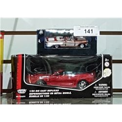 2 DIE CAST CARS IN BOXES