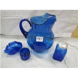 LOT OF 4 PIECES OF BLUE GLASS (PITCHER, PIGGY BANK, PEPPER SHAKER AND JAR)