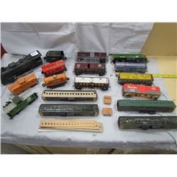 LOT OF 17 TOY TRAIN CARS ( ENGINES, CABOOSE, ETC…)