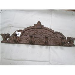 CAST IRON TOWEL RACK ( HOT BATH-25 CENTS, SOAP AND TOWEL-10 CENTS EXTRA)