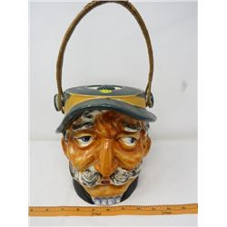 COOKIE JAR (CERAMIC, HAND PAINTED SHAFFORD, WICKER HANDLE) *INSIDE RIM CHIPPED*