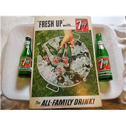 LOT INCLUDING 2 7-UP BOTTLES AND A 1965 7-UP CARDBOARD ADVERTISMENT (12X18)