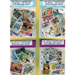 FOUR 100 STAMP PACKAGES- BEAUTIFUL ASSORTMENT