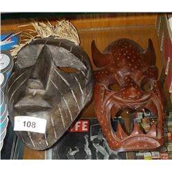2 CARVED INDONESIAN MASKS