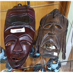 2 CARVED WOOD AFRICAN MASKS
