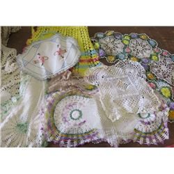 LOT OF 20+ DOILIES AND CHILD'S CROCHET APRON