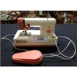 VINTAGE MINIATURE CRYSTAL BATTERY OPERATED SEWING MACHINE