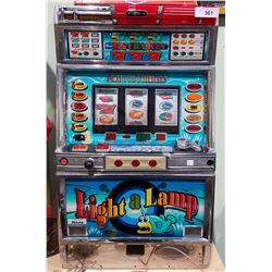 LIGHT A LAMP SLOT MACHINE