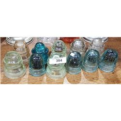 ELEVEN ANTIQUE GLASS INSULATORS