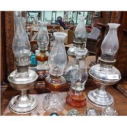 FOUR VINTAGE OIL LAMPS
