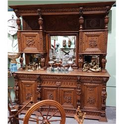 1860 ORNATE HIGHLY CARVED EUROPEAN OAK CABINET W/FIGURAL MIRRORED GALLERY