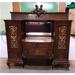 1880'S BEAUTIFULLY CARVED OAK SIDEBOARD W/RARE FIGURAL CARVED CHILDREN ON TOP OF GALLERY