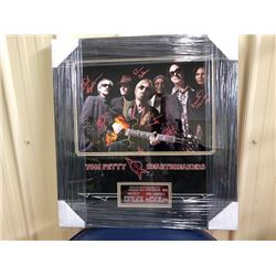 RARE FRAMED SIGNED PHOTOGRAPH OF TOM PETTY AND THE HEARTBREAKERS. AUTOGRAPHED BY TOM PETTY, BENMONT