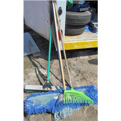 LOT OF ASSORTED BROOMS AND YARD ITEMS