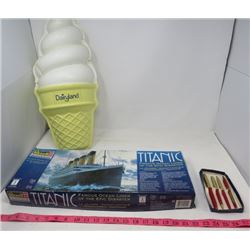 LOT OF 3 COLLECTABLE ITEMS (TITANIC MODEL WITH BOX) *4 PENS WITH BOX* (DAIRYLAND PLASTIC SIGN)
