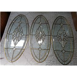 THREE BEVELLED GLASS OVAL WINDOWS