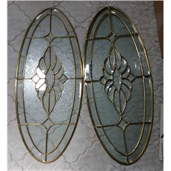 TWO BEVELLED GLASS OVAL WINDOWS