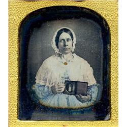 Daguerreotype   WOMAN WITH A DAGUERREOTYPE OF HER HUSBAND.