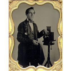 Ambrotype   DAGUERREOTYPIST WITH LEWIS-TYPE CAMERA, TRIPOD.