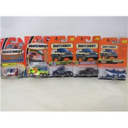 LOT OF 5 MATCHBOX VEHICLES (RAPIDS RAFT, BADGE BLASTER, MERCEDES BENZ E CLASS, FIRE FLOODER, KENWORT