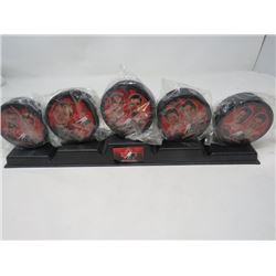 MCDONALDS PUCK SET WITH STAND (PUCKS ARE STILL IN PACKAGING)