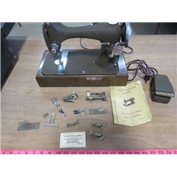 SEWING MACHING (VINTAGE) *ELECTRIC* (COMES WITH EXTRA FEET AND ACCESSORIES) *WITH BOX* (ORIGINAL MAN