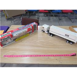 LOT OF 2 SEMI TRUCK TOYS (1 METAL FORD W/REMOVEABLE TRAILER) *CANADIAN TIRE TANKER IN BOX-REMOTE CON