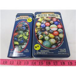 2 TINS WITH MARBLES