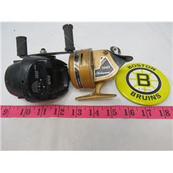 TWO FISHING REELS AND A BOSTON BRUINS PEN
