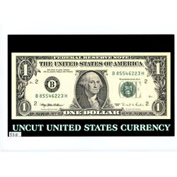Lot of 4 uncut U.S. 1995 $1 notes in folder marked Uncut United States Currency.
