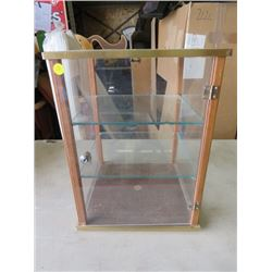 "SHOWCASE WITH GLASS SHELVES ( 17"" TALL X 12"" LONG X 12"" WIDE) *SMALL GLASS CHIP*"