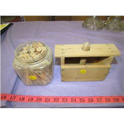 LOT OF WOODEN CLOTHES PINS AND BUTTER PRESS