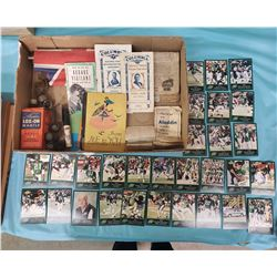 LOT OF COLLECTIBLES INCLUDING SASKATCHEWAN ROUGHRIDER FOOTBALL CARDS, FLAGS ETC