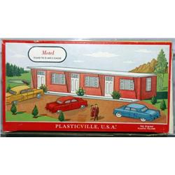 PLASTICVILLE MOTEL. SALMON WALLS, WHITE ROOF AND