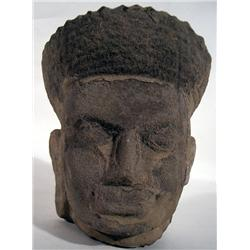 A SUPERB AND RARE KHMER SANDSTONE HEAD,c.13th Cen