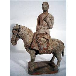 A FINE NORTHERN QI CERAMIC HORSE AND RIDER,c.550-