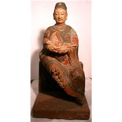 A RARE EARLY CHING DYNASTY SCULPTURE OF A NURSING