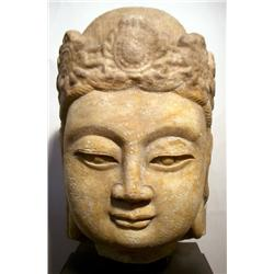 A SUPERB JIN DYNASTY HEAD OF BUDDHA,sculpted from