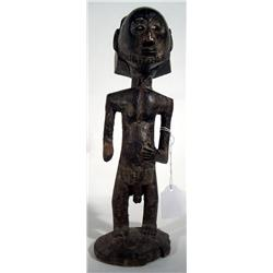 AN OLD HEMBA SCULPTURE,of wood standing on circul
