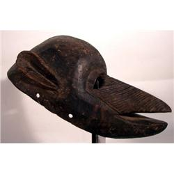 AN OLD BAMANA CEREMONIAL MASK,of wood in zoomorph