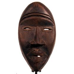 AN OLD DAN CEREMONIAL MASK,of wood, the classic v