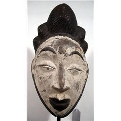 AN OLD PUNU ANCESTOR MASK,of wood, the convex vis