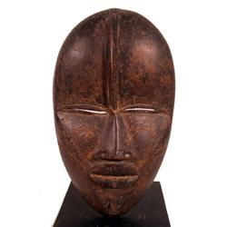 A FINE AND EARLY DAN FACE MASK,of wood, in ovoid