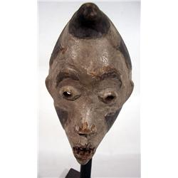 A WEST AFRICAN CEREMONIAL MASK,of diminutive form